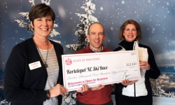 The American Birkebeiner Ski Foundation receives a $12,450 JEM Grant from the Wisconsin Department of Tourism. From left: Regional Tourism Specialist Julie Fox with Ben Popp and Nancy Knutson of the American Birkebeiner Ski Foundation.